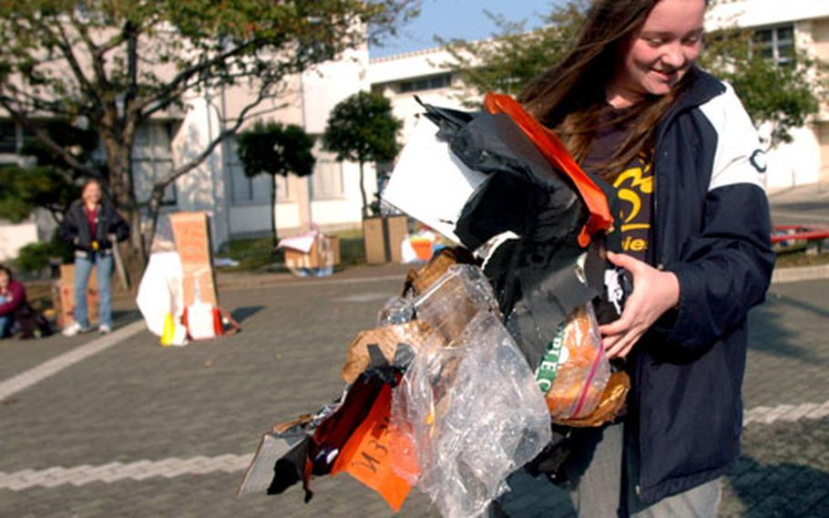 Water inside the plastic bag containing Kylie Richmond's pumpkin did not have the buffering effect the Nile C. Kinnick physics student had hoped for when her pumpkin was dropped from 65 feet - but everyone agreed it made the best explosion.