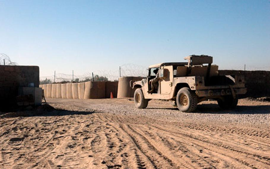 A truck rolls through the newly constructed gate that will serve as a main entry point for Camp Normandy.