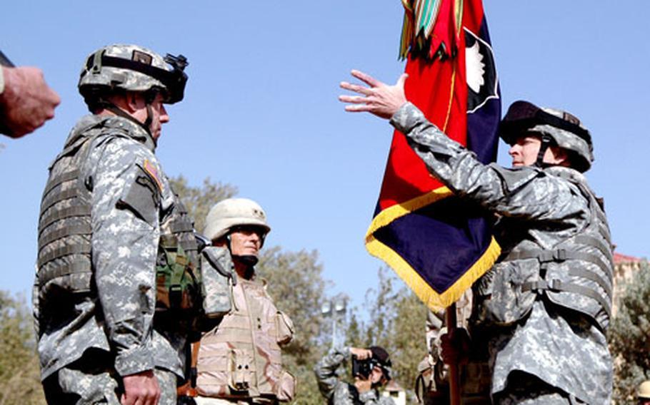Maj. Gen. Tom Turner, right, receives the colors from Maj. Gen. Joseph Taluto, center left.