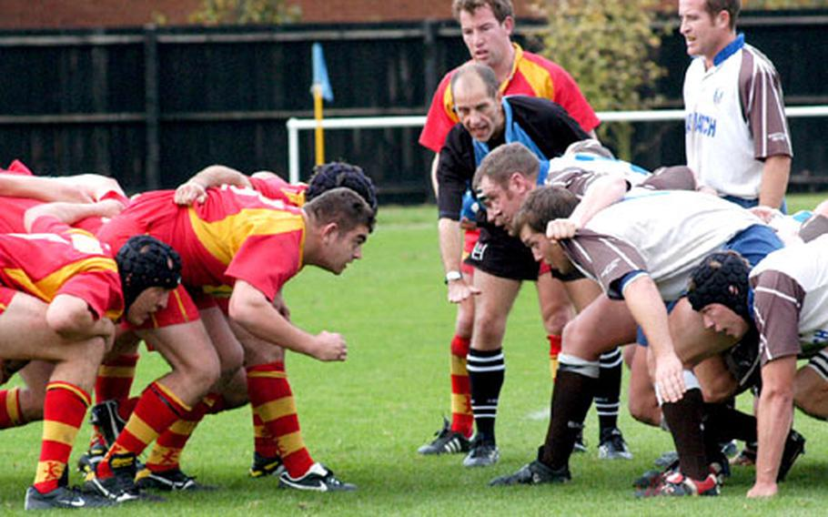 Members of the Cambridge Rugby Union Football Club, left, and the Southend Rugby Football Club, get set for a scrum-down in a recent test at Cambridge.
