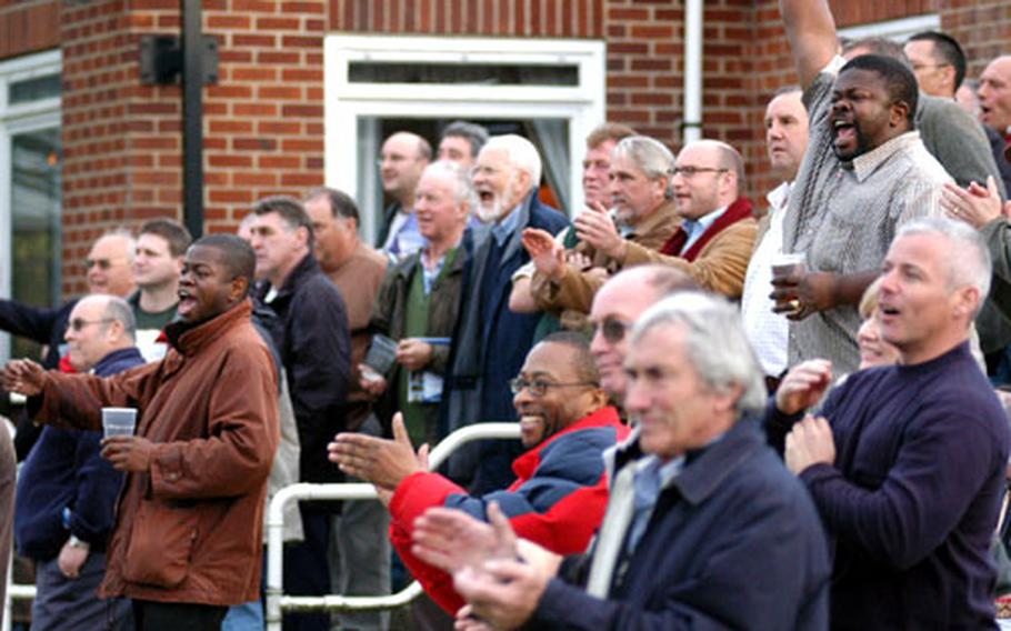 Fans get into the action as the Southend Rugby Football Club takes on the Cambridge Rugby Union Football Club.