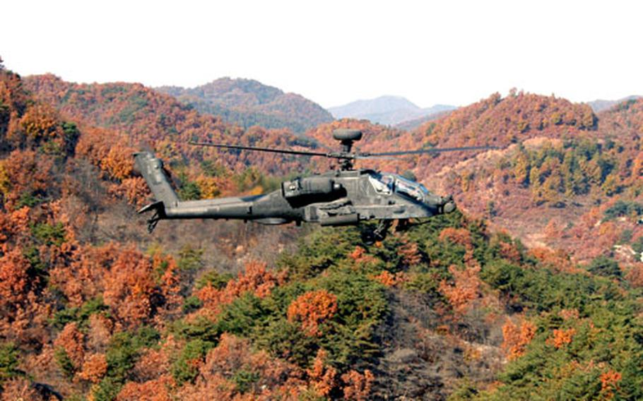 A 3rd Squadron, 6th Cavalry Regiment Apache flies above the trees at Rodriguez Range on Monday.