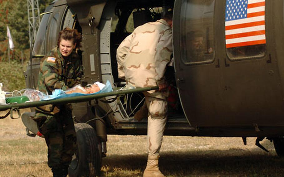 Lt. Col. Linda Lebedovych helps evacuate a baby Tuesday to an Islamabad hospital after the baby spent the previous night attached to a ventilator in the 212th MASH ICU.
