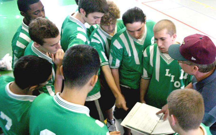 The Livorno Lions boys volleyball team takes a timeout Thursday to go over plays with coach James Bartell during preliminary round of the Mediterranean boys tournament, held this week at Naval Support Activity Naples, Italy.