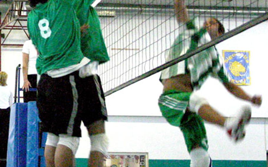 Teammates from the Livorno Lions, at left, go up for a block against a player from Ankara High School on Thursday.