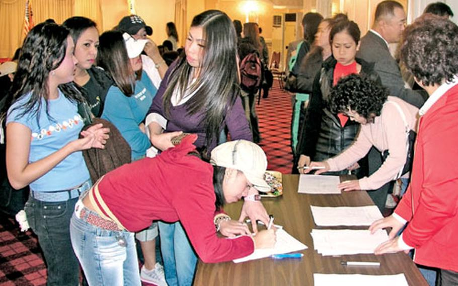Employees from the club district outside Camp Humphreys in Pyeongtaek, South Korea, sign in at the Enterprise Hotel before a recent training session on curbing prostitution and human trafficking. The session was hosted by the Army's Area III Support Activity at Camp Humphreys and Pyeongtaek City officials. Club owners and workers were invited.