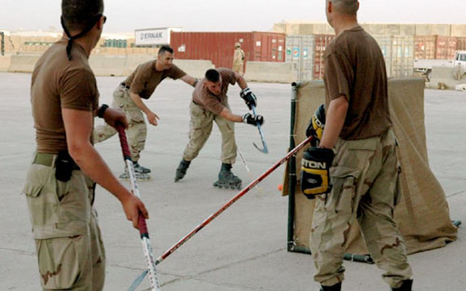 Soldiers at Camp Warhorse have started pick-up street hockey games as a way to relax when off duty.
