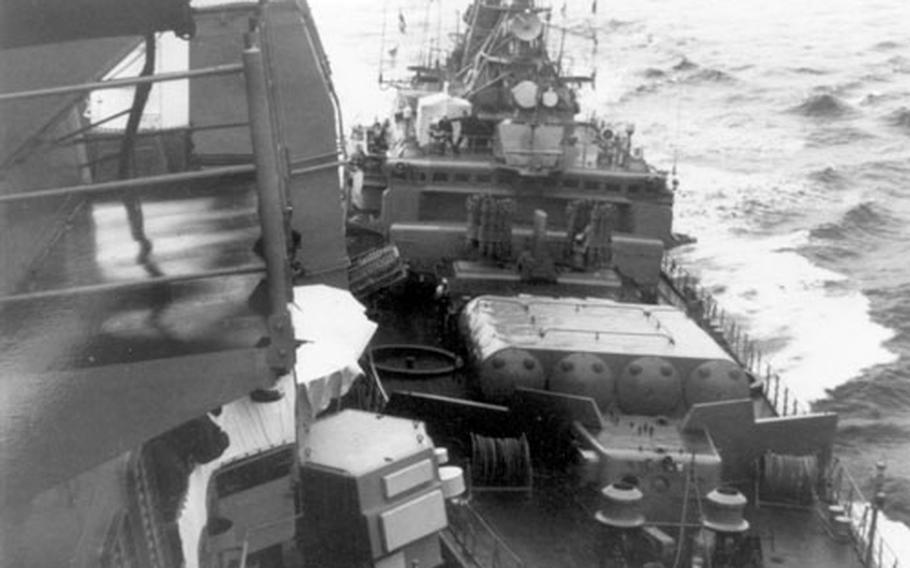 """A Soviet Krivak-class frigate shown here from the deck of the USS Yorktown on Feb. 12, 1988, hit the Yorktown as it passed though Soviet territorial waters in the Black Sea. The ships were engaged in """"shouldering,"""" a close-quarters maneuver used extensively during the Cold War."""