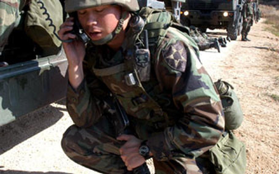 """Platoon commander 2nd Lt. John Abella, 23, of Yorba Linda, Calif., calls for a medevac after an """"improvised explosive device attack"""" during training in Warrior Valley on Monday."""