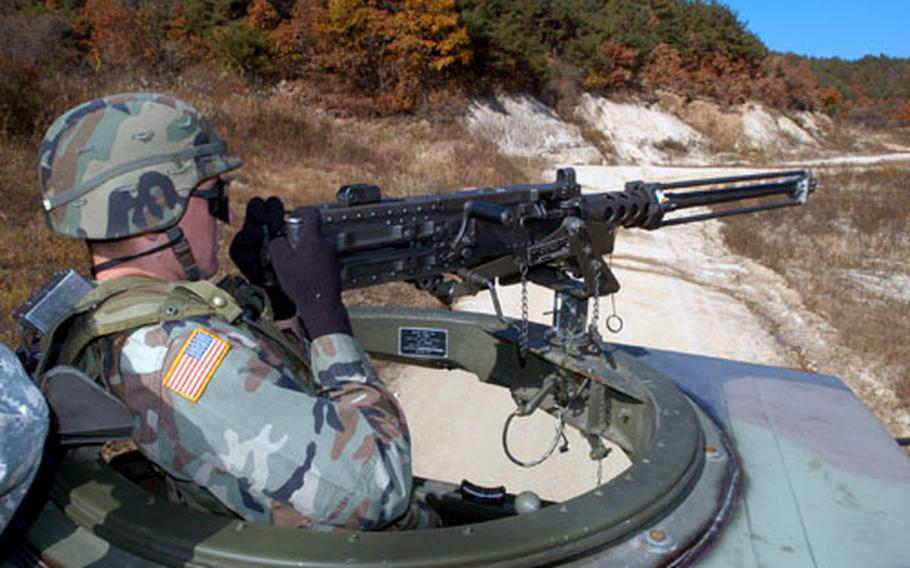 A Company A, 602nd Aviation Support Battalion soldier lines up targets.