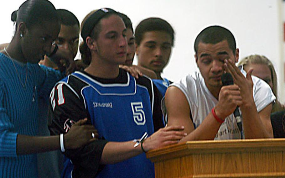Josh Liliu, right, wipes away tears as he speaks Friday during a memorial service for Bryan Anthony Burnette, 18, at the Patch Fitness Center in Stuttgart, Germany. Burnette, 18, died Oct. 30, 14 days after he went into a coma after suffering an asthma attack. From left are friends Jamila Farah, Daniel Liliu, Paul Schwarzenberger, Stephen Perges and Jasmine Arbinger.