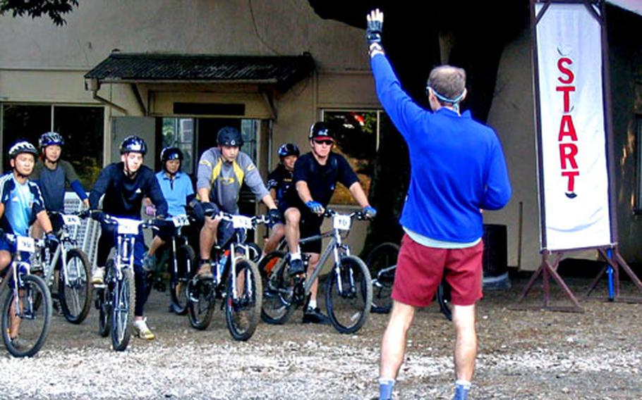 Riders in the rookie and women's categories await the signal to start the Tour de Tama mountain bike race Saturday morning at the Tama Hills Recreation Area west of Tokyo.