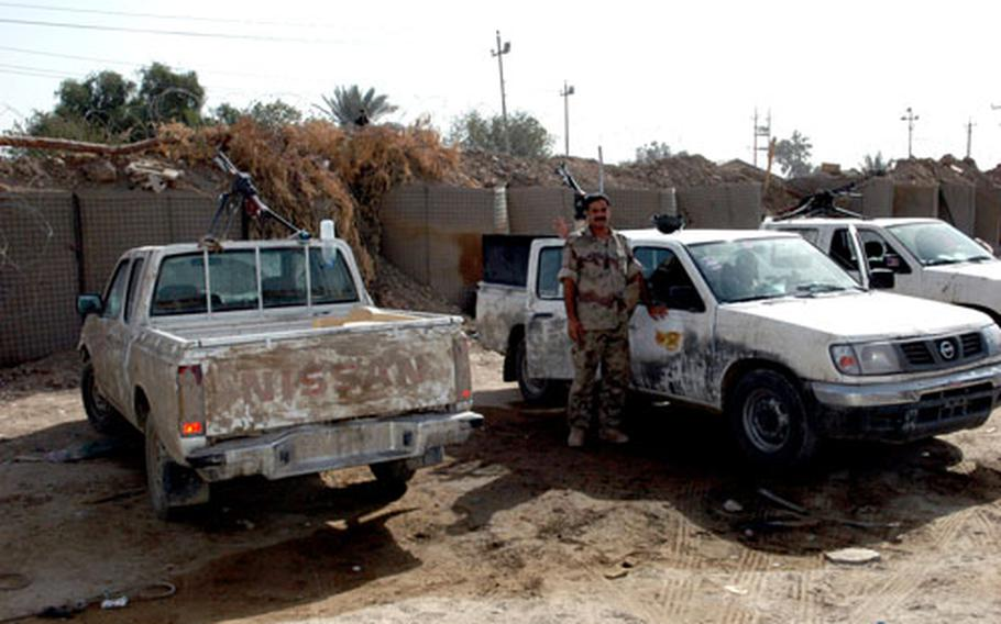 An Iraqi soldier prepares to go out in an unarmored Nissan pickup that most Iraqi army units use as their primary vehicle.