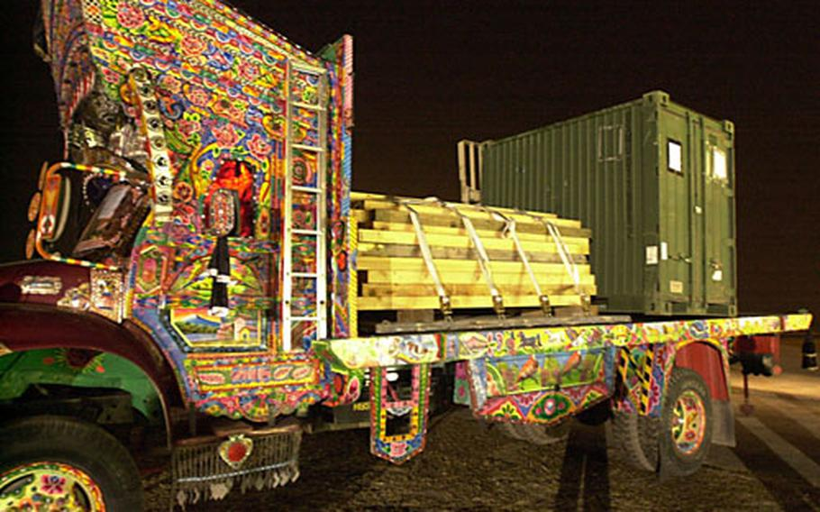 """A """"jingle truck"""" loaded with gear for the III MEF detatchment."""