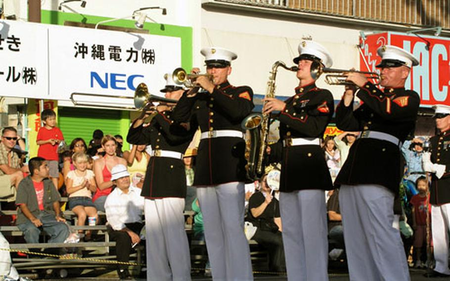 III Marine Expeditionary Force band members perform at the 13th annual Okinawa International Carnival on Gate Two Street in Okinawa City on Sunday.