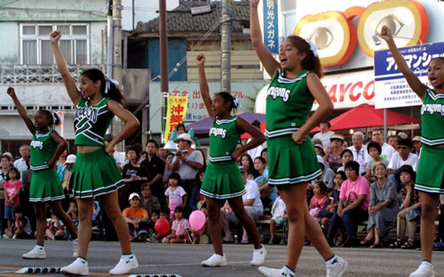 The Kubasaki High School Dragon cheerleaders get the crowd warmed up Sunday at the 13th annual Okinawa International Carnival in Okinawa City.