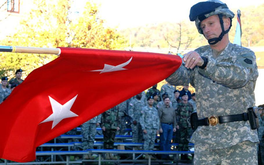 V Corps deputy commander Maj. Gen. Daniel Hahn unfurls his new two-star flag after being promoted during a Tuesday ceremony at Campbell Barracks in Heidelberg, Germany.