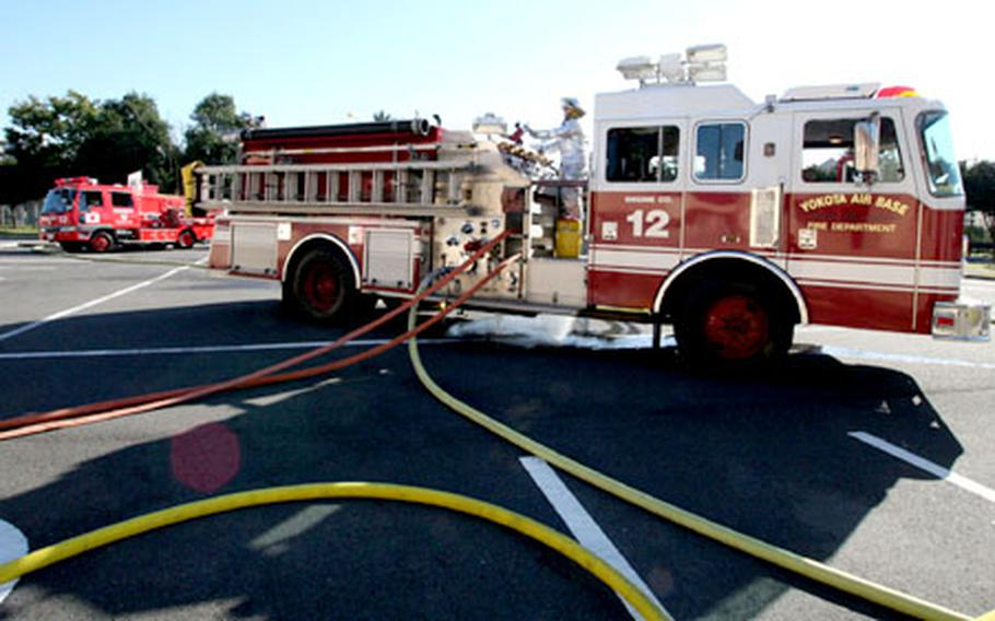 Yokota firefighters linked up with their counterparts from nearby Fussa City on Wednesday for a joint exercise centered around a mock rescue operation at the base's Taiyo Recreation Center. The event helped kick off Japan's annual Fall Fire Prevention Week.