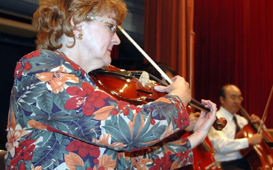 DeEtte Hassen, a viola player and music teacher, rehearses with the Sasebo Shimin Orchestra.