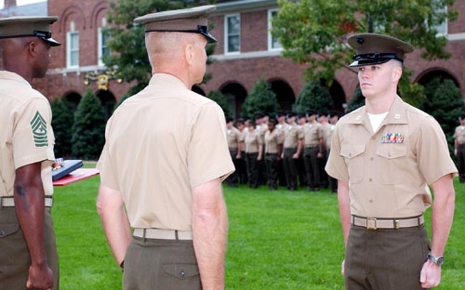 General Michael W. Hagee, center, commandant of the Marine Corps, prepares to award the Silver Star to Capt. Joshua L. Glover, right, on Oct. 28 at the Marine Barracks in Washington.