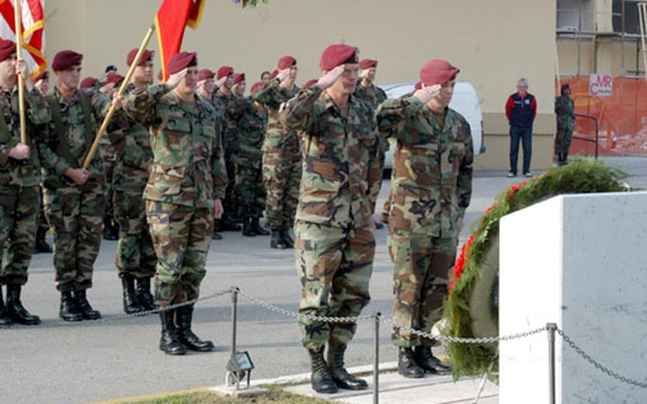 Lt. Col. Michael Shinners, commander of the 173rd Airborne Brigade rear detachment, and Bobby Wooldridge, first sergeant of the brigade's headquarters company, lead a formation of Sky Soldiers in saluting nine comrades who died during the brigade's year in Iraq.