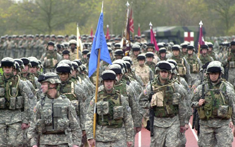 Combat team members walk in formation during Thursday's ceremony.