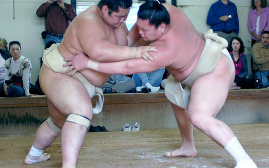 Sumo wrestlers practice at Azumazeki Beya in Fukuoka, Japan, which was opened in April 1986 by Azumazeki Oyakata, the sumo master name assumed by Jesse Kuhaulua, a Hawaiian native.