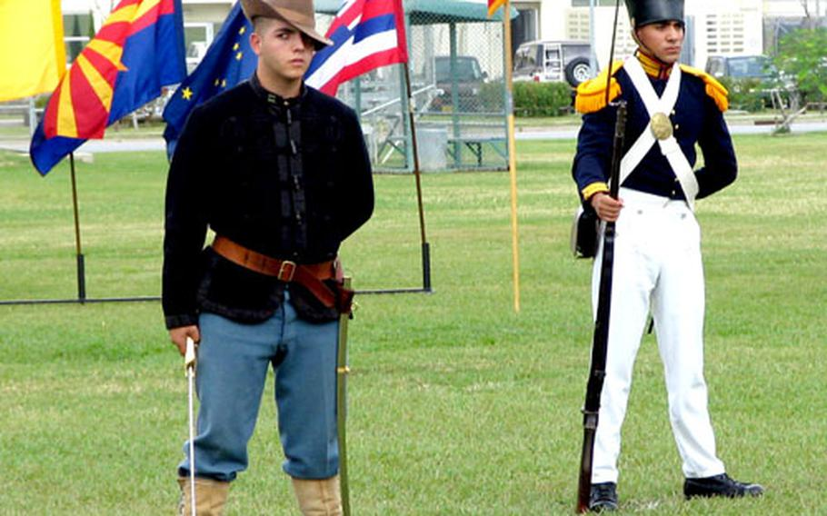 Marines dressed in the uniforms worn during the Spannish American War and the Mexican War, at Thursday's celebration.