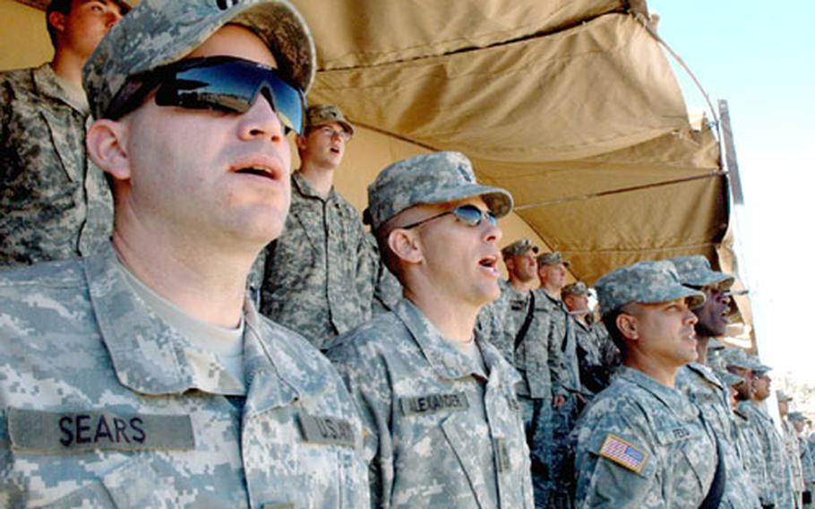 101st Airborne Division (Air Assault) soldiers sing along to the division song during Friday's Veterans Day ceremony at Forward Operation Base Warrior in Iraq.