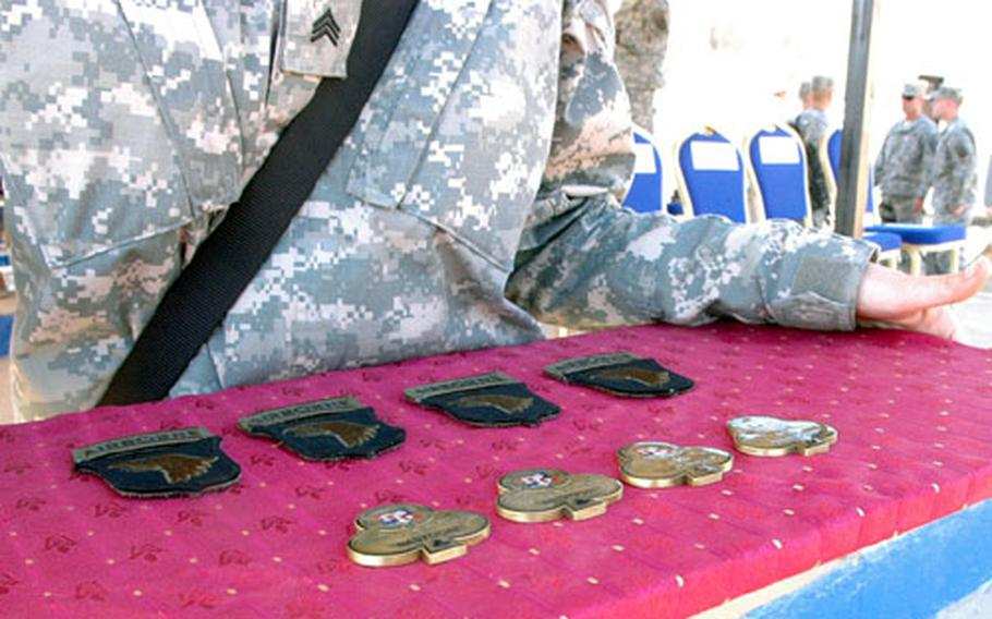 101st Airborne Division soldiers were given combat patches during Friday's ceremony, and coins were given to airmen in attendance.