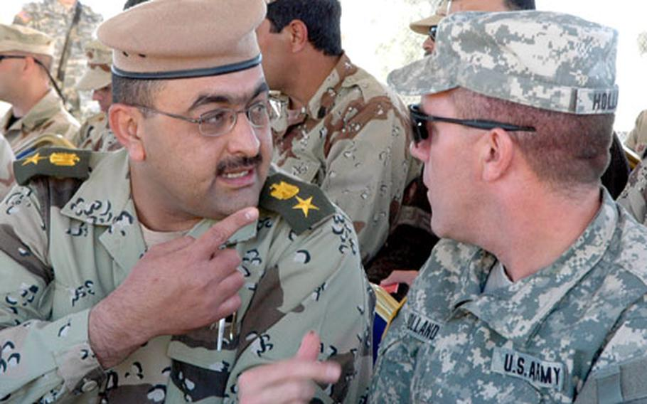 American and Iraqi soldiers met during Friday's Veterans' Day ceremony.