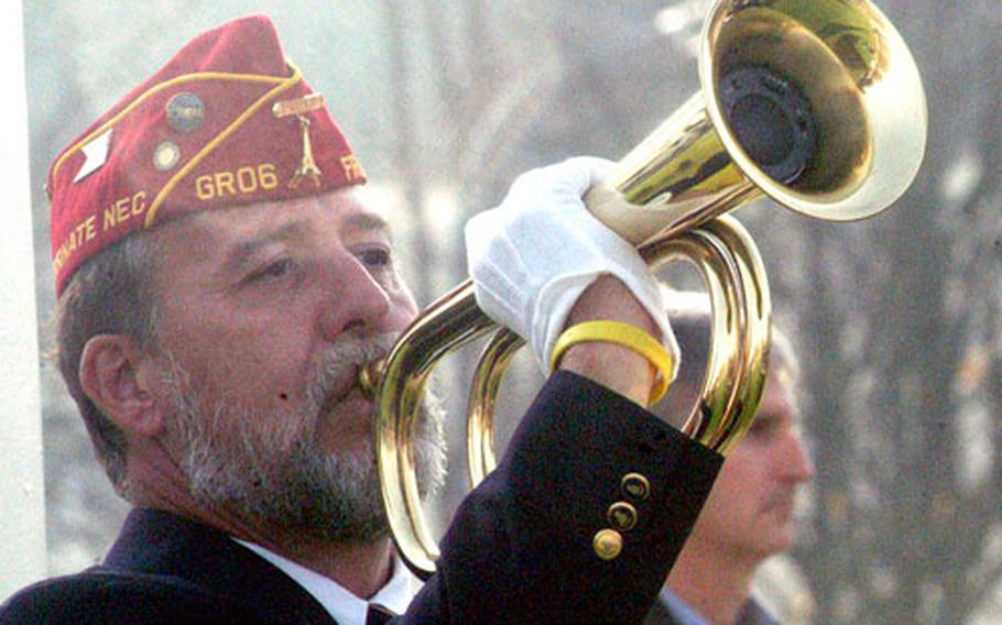 Michael Umland of American Legion Post 6 plays taps during a Veterans Day observance on Friday at Patch Barracks in Stuttgart, Germany.