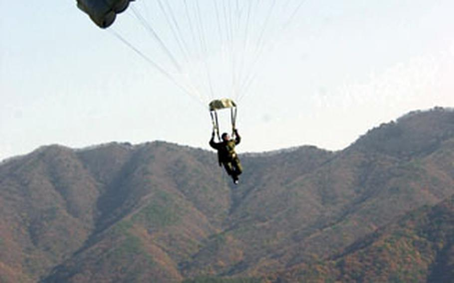 A jumper comes in for a landing at a drop zone near Seoul during jump training Wednesday.