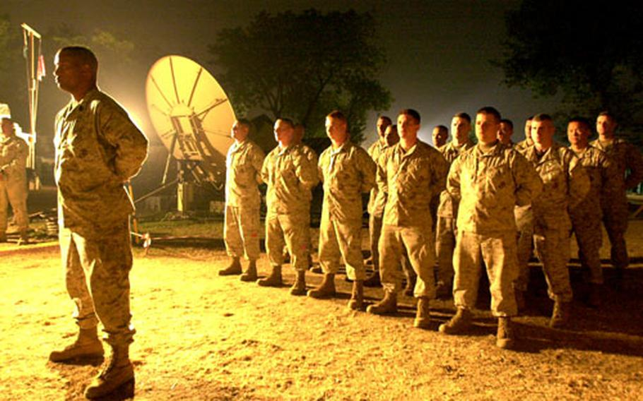 Marines stand in formation Thursday evening during the cake-cutting ceremony.