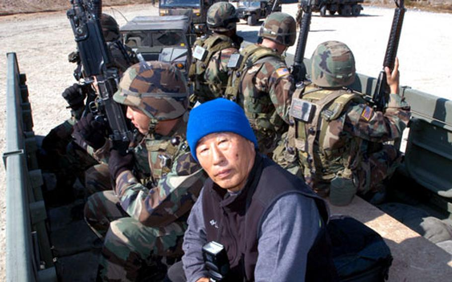 Yu Hu-son, 2nd Infantry Division photographer, rides with U.S. soldiers during a training exercise late last month.