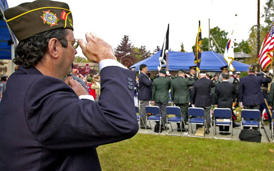 Mike Stephens, senior vice commander of the Veterans of Foreign Wars Department of Pacific Area III, salutes Friday as the colors are presented during a Veterans Day ceremony on Yongsan Garrison, South Korea.