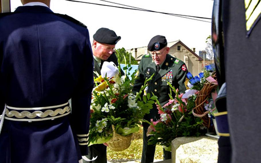 Eighth Army Commander Lt. Gen. Charles Campbell, left, and Command Sgt. Maj. Barry Wheeler place a floral tribute.
