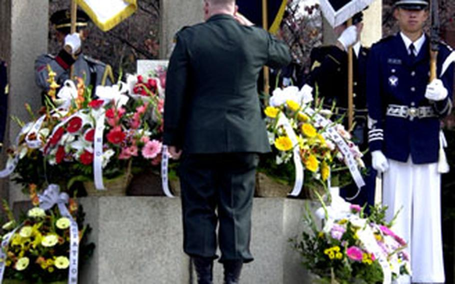 Col. David S. Maxwell, chief of staff of the Special Operations Command Korea, salutes after placing a floral tribute Friday.