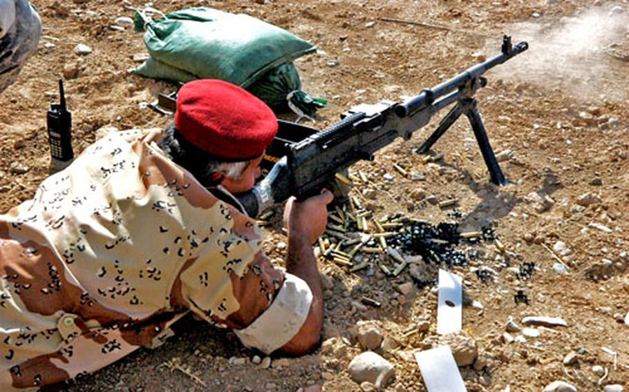 Iraqi Lt. Col. Yashar Midhat takes an American M240B for a spin during a training exercise at an Iraqi Army base in Kirkuk last week. Midhat smoked Capt. Cole Calloway of Company B, 451st Civil Affairs Battalion, an Army Reserve unit, in a shooting contest using AK-47s to hit a cigarette in the ground at 25 meters.