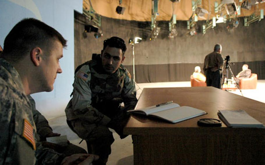 Maj. Gregory Bishop, left, and a U.S. Army interpreter observe a taping of a political show at the Iraqi Media Network studio in Kirkuk. As a public affairs official, Bishop often observes the local media.