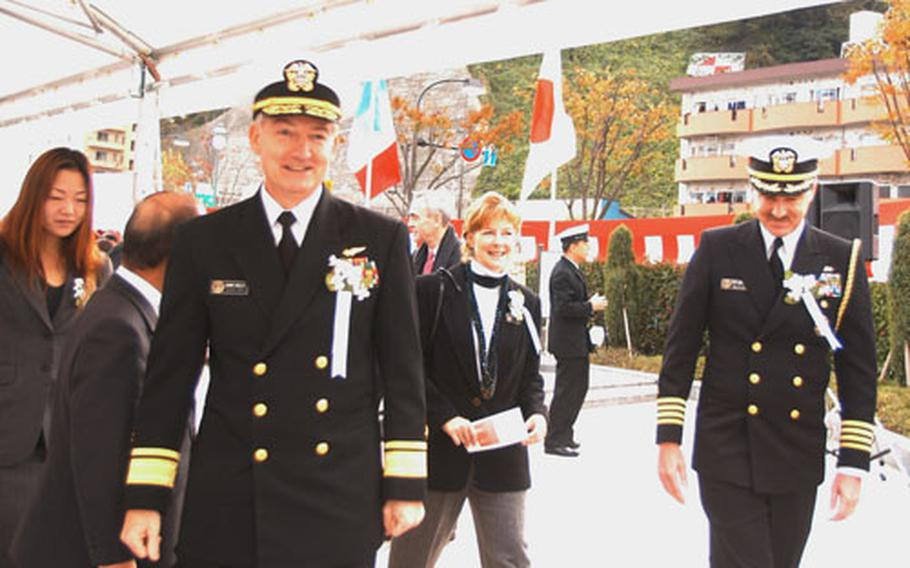 U.S. Navy personnel, including Rear Admiral James Kelly, turned out for Sunday's ceremony.