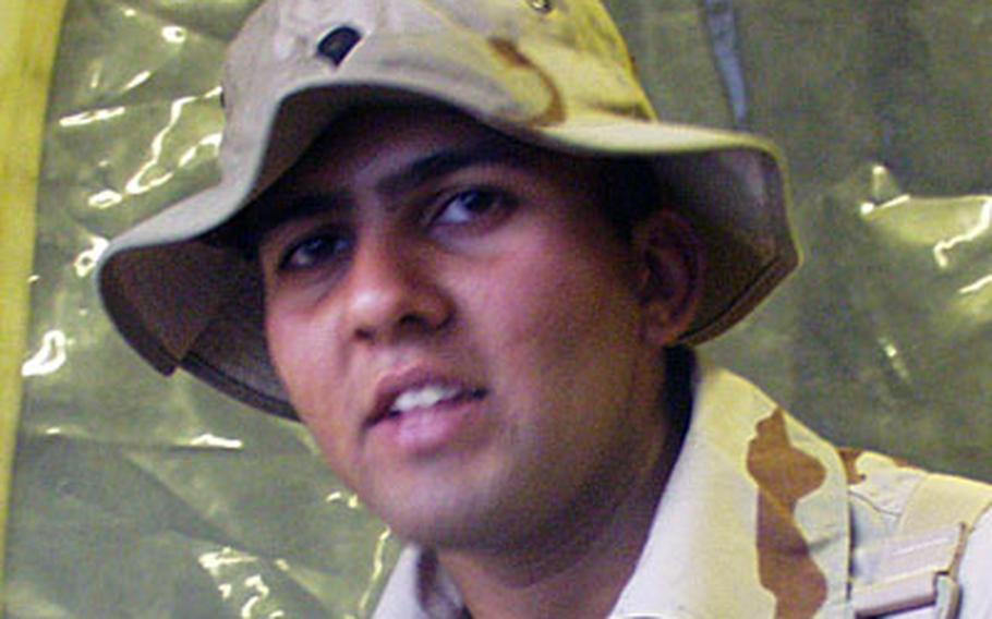 Spc. Abbas Farooqi, 21, was born in Karachi and came to the United States when he was 15.