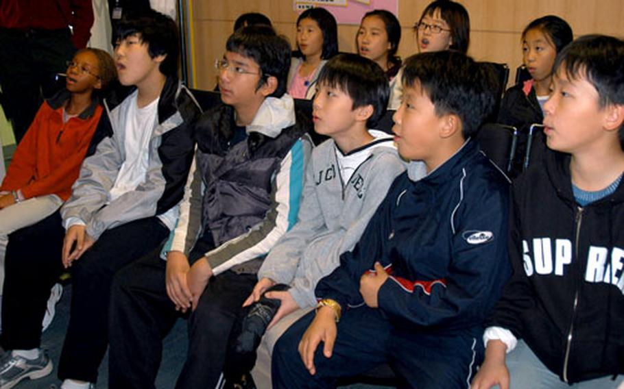 South Korean and American students take a class in broadcasting Thursday afternoon at the Seoul English Village. The English-language school teaches Korean students ages 11 to 13 about life in America.