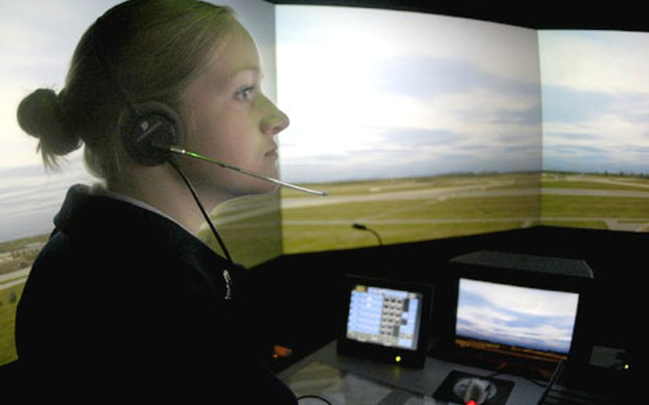 """Air traffic controller Airman 1st Class Allison Kornbau looks over RAF Lakenheath's """"flightline"""" at the base's new $1 million simulator. """"It's realistic,"""" said Kornbau, who has been an air traffic controller at Lakenheath for less than a year. """"You look out the windows [of the real tower] and see the exact same thing."""""""