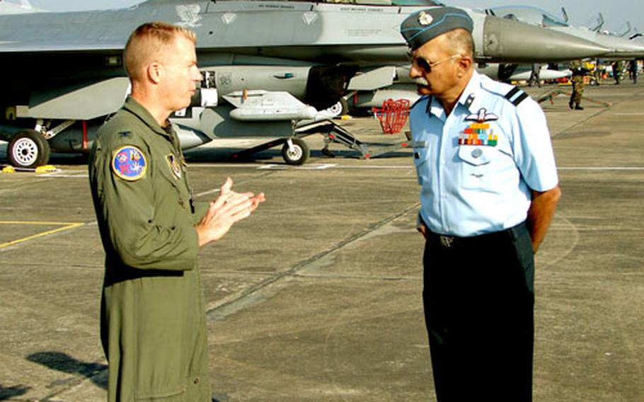 Col. Rusty Cabot talks with Indian air force general B.C. Nanjapa at Kalaikunda Air Station, India. A dozen F-16s from Misawa Air Base, Japan, are deployed to India for the Cope India '06 exercise.