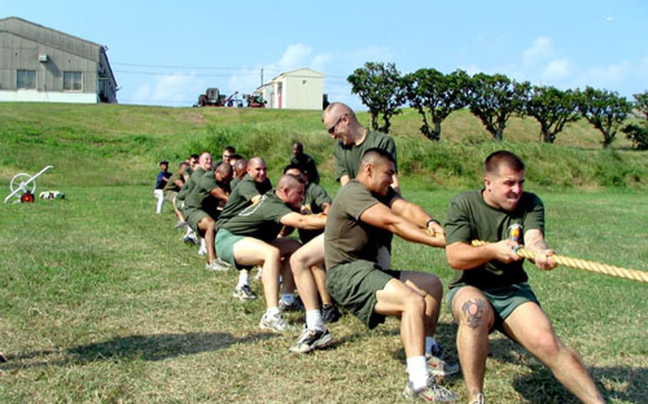 Marines from the 3rd Marine Division, Camp Hansen, pull their way to a win in Tuesday's tug-of-war championship against Marine and Japan Ground Self-Defense Force teams at Sports Exchange Day at Camp Naha, Okinawa.