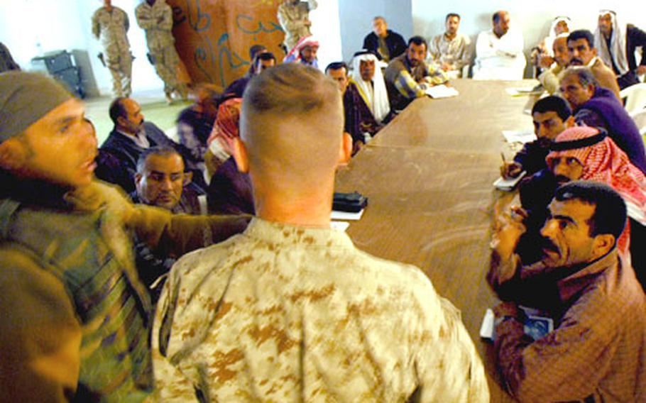 Iraqis voice concerns to Maj. Sean Hurley during the first meeting between U.S. Marines and local leaders after the battle of Husaybah last week.