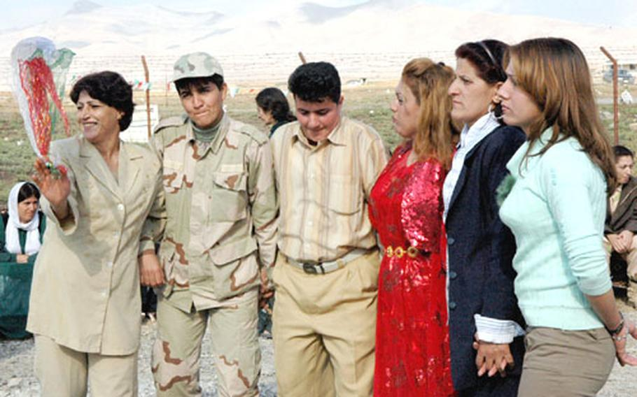 In Sulaymaniyah, Iraq, Kurdish women celebrate the Peshmerga, the Kurdish freedom-fighting militia, which fought doggedly against Saddam Hussein's regime. Now, many say they want an independent nation.