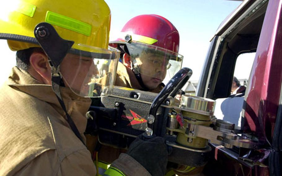 """Yongsan Garrison firefighters use the """"jaws of life"""" during the extraction training."""