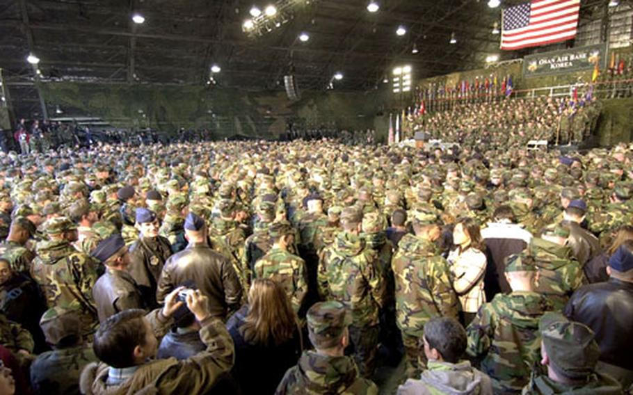 Members of all the services crowd into a hangar Saturday while awaiting the president's arrival.